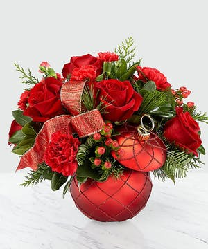 An elegant combination of red roses, carnations and berries!