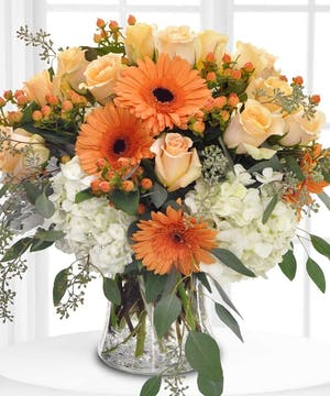 Enjoy this autumn arrangement, hand delivered by Boesen the Florist!