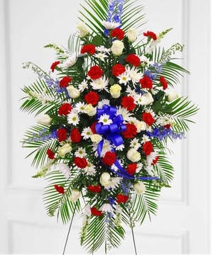 This patriotic spray will provide a flawless tribute.