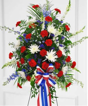 This patriotic spray will provide the honor that your loved one deserves.