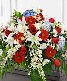 This patriotic casket spray is sure to honor your loved one.
