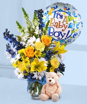 Welcome a new baby boy with this bright arrangement!