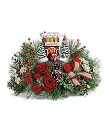 Set atop a magnificent bouquet of festive flowers!