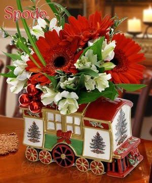 The second in our series of hand painted keepsake Spode trains filled with holiday flowers. Complete with a gift box for safe keeping.
