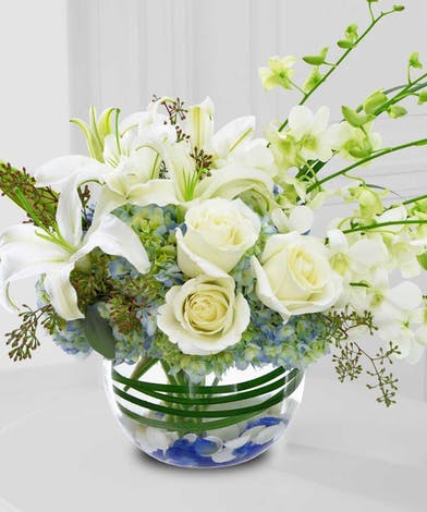 Start the New Year out right with this beautiful bowl of fresh white flowers!