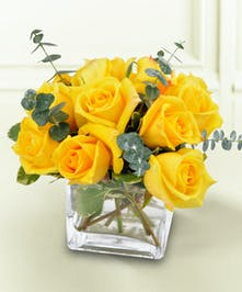 This beautiful display of yellow roses is sure to show the feelings of friendship and joy that you share with that special someone.