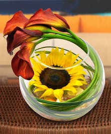 This modern design of sunflowers and calla lilies will help you ease into the beauty of the autumn season!