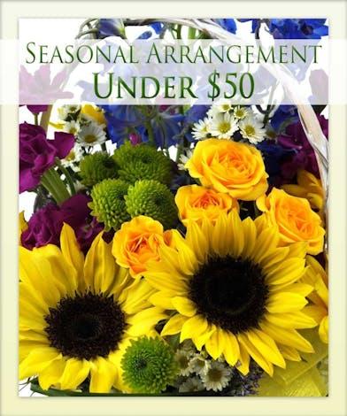 Give the best seasonal arrangement from Boesen the Florist!