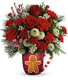Lush holiday bouquet arranged in an oversized mug!