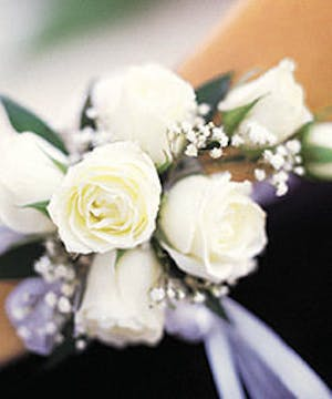 Bright white roses accented with ribbons