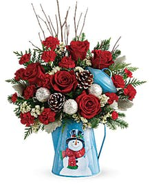 Lush mix of red roses and winter greens delivers classic Christmas style!
