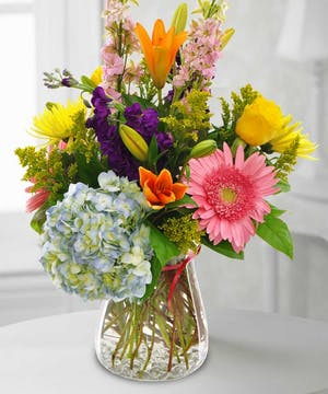 Let someone special know you're thinking of them with this one-size-fits-all bouquet featuring Lilies, Gerbera Daisies, Roses, Hydrangea, Snapdragons and more!