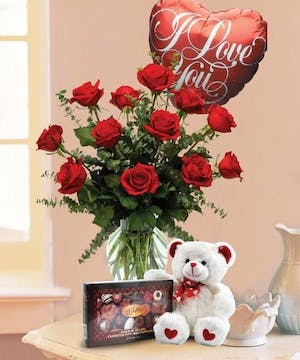 This all-inclusive combination includes stunning red roses, delectable chocolates, a Valentine's Day balloon and an adorably huggable bear!