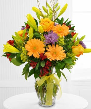 Give a ray of sunshine with this beautiful bouquet from Boesen the Florist!