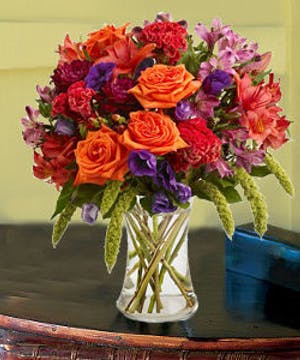 This unique fall arrangement is full of the richest hues of the season!