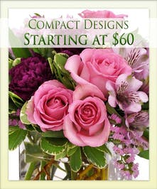 Enjoy a compact floral design from Boesen the Florist!