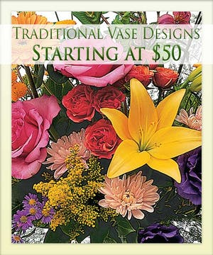 Enjoy a traditional vase design from Boesen the Florist!
